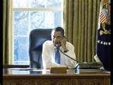 Images of Obama vows to support veterans, steers back to foreign policy